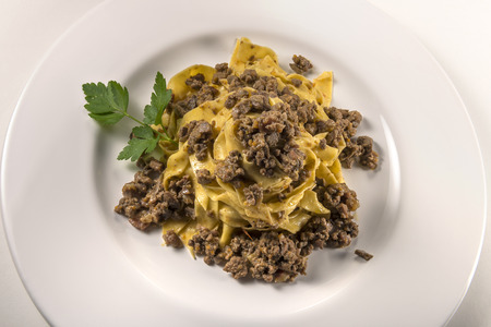 Pasta dish bolognese fettuccine isolated on white Stock Photo