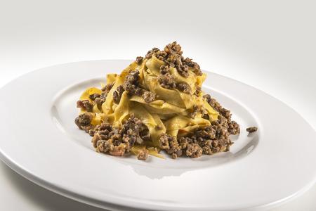 Pasta dish bolognese fettuccine isolated on white 免版税图像