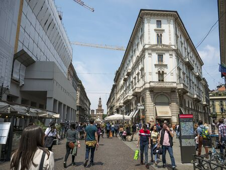 Milan, Italy - May 25, 2019: Crowd of tourists strolls for Saturday shopping in Dante street Milan