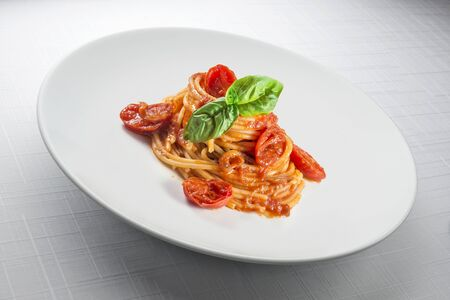 Plate with spaghetti tomato and basil Italian food symbol