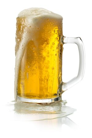 Glass of blonde beer with foam isolated on white