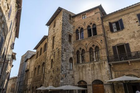 San Gimignano Siena Tuscany Square of the cistern Tortoli palace partial view