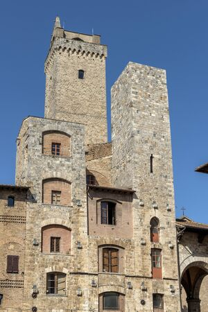 San Gimignano Siena Tuscany tower Ardinghelli and Torre Grossa in the square of the cistern Stockfoto
