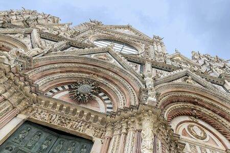 Detail of the statues on the upper part of the facade of the cathedral of Siena