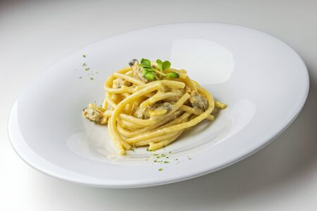 Plate of Spaghetti with cheese and pepper with clams isolated on white