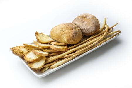 Plate with Assortment of Bread Crostini and Breadsticks