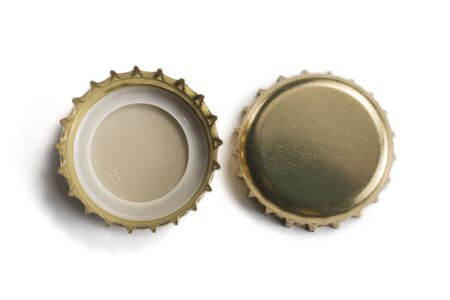 Top view of Golden crown caps without logos isolated on white background 写真素材