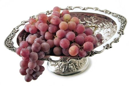 Top view of Silver plated basket with bunches of red grapes 写真素材