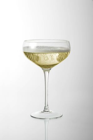 Glass cup with sparkling wine with foam