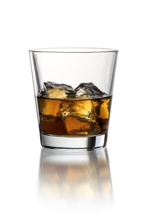 Glass with whiskey on the white