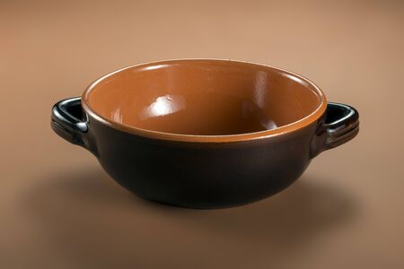 Brown earthenware casserole typical of Tuscany