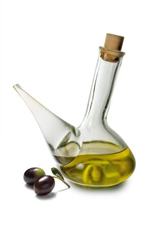 Glass oil bottle with spout and olives isolated on white