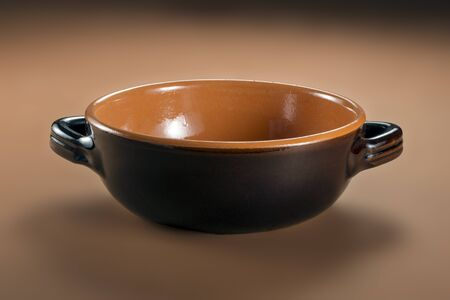 Brown earthenware casserole typical of Tuscany with clipping path 写真素材