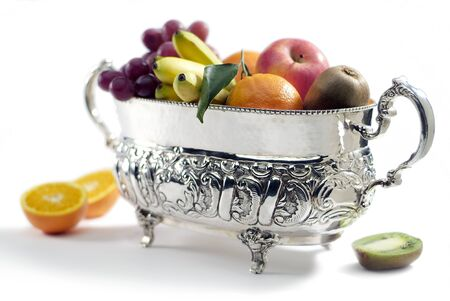 Silver plated basket with different fruit isolated on white background 写真素材