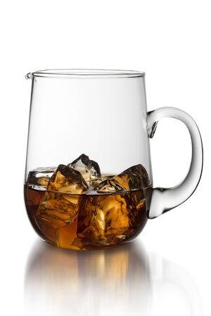 Pitcher with tea and ice  on white