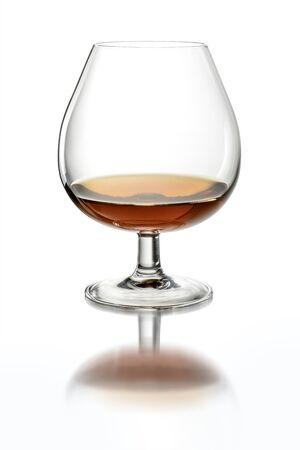 Napoleon type glass with Cognac on white