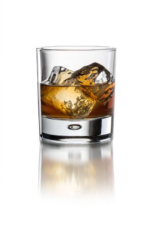 Glass with whiskey on white