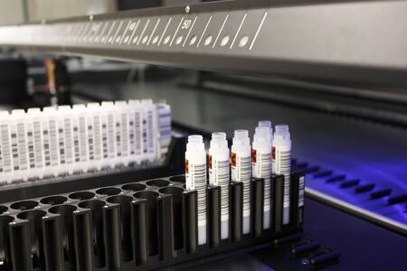 Milan, Italy - March 17, 2020: Rack with test tubes of blood and barcode in the analysis laboratory