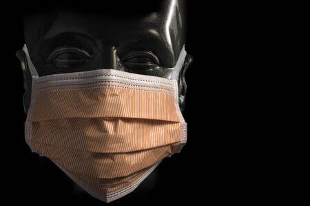 Surgical protective orange Mask on Transparent Dummy isolated on black background 写真素材