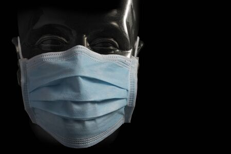 Surgical protective blue Mask on Transparent Dummy isolated on black background 写真素材