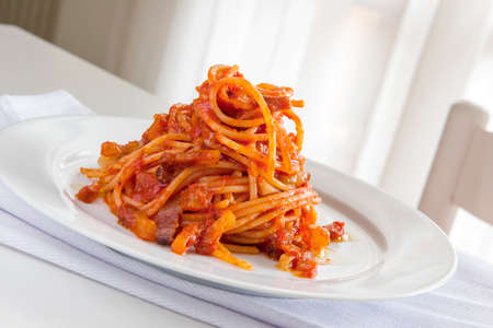 Plate of spaghetti pasta with tomato and pork cheek 写真素材 - 166126943