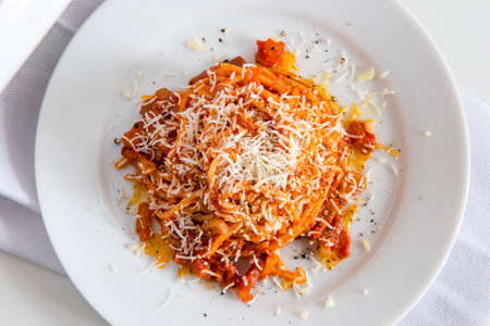 Top view of Plate of spaghetti with tomato and bacon and pecorino cheese 写真素材