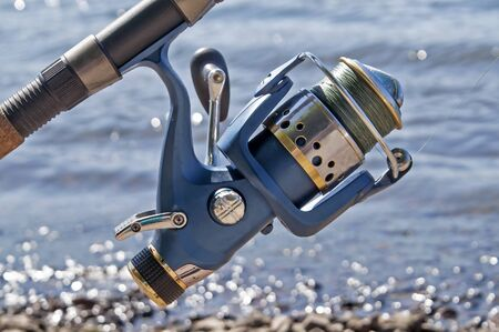 tench: The blue coil for fishing on a spinning in the sunny summer day Stock Photo