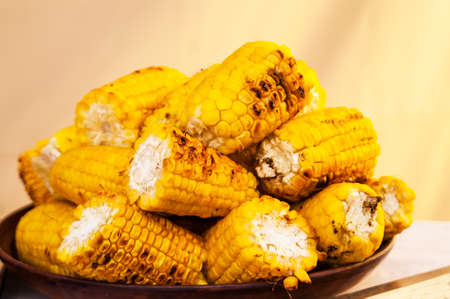 red cross red bird: corn, beautifully cut and subfried on grill