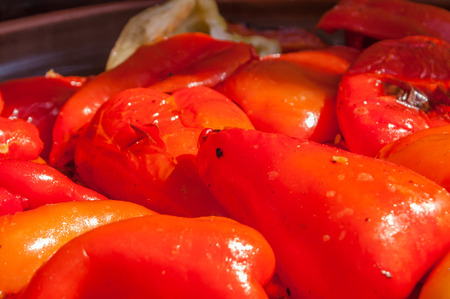 thoroughly: Sweet pepper of red shades was cut, fried thoroughly on a fire and laid out in a plate