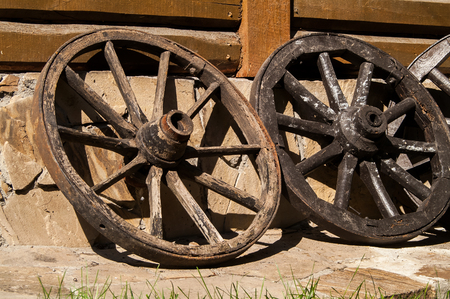 wheel house: old wooden wheel standing near the house Stock Photo