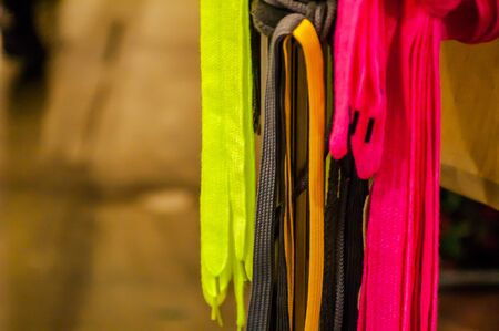 end of rainbow: a lot of different colors hanging laces for shoes