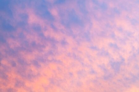 blue cloudy sky: Autumn red gray clouds in the blue sky during the autumn sunset
