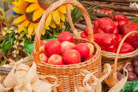 harvest cone cornucopia: composition of apples and peppers in baskets celebration
