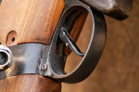 flintlock: the trigger on the military historic gun closeup