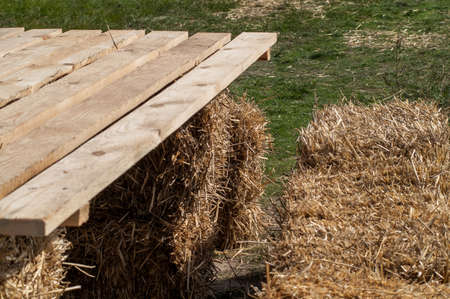 contiguous: makeshift table made of planks and bales of hay