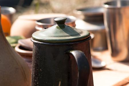 pewter mug: clay and metal mug sunny day on earth