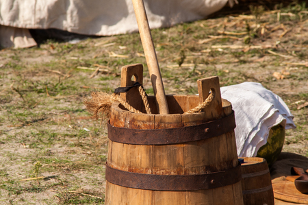 hogshead: medieval historic wooden bucket with a mop