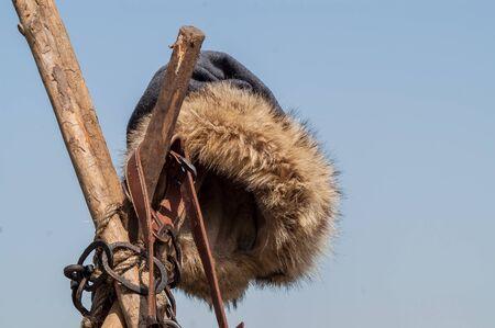 pilgrim costume: historical fur hat medieval blacksmith hanging on the tree