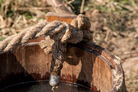 antik: medieval historic wooden bucket with a mop