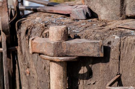forgeman: medieval iron tongs and anvil blacksmith closeup Stock Photo