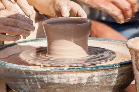 craftswoman: The process of manufacture of arms and training on the machine pottery Stock Photo
