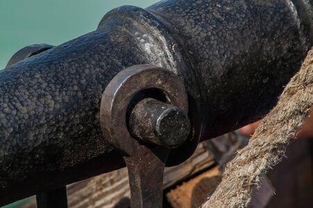 sail ship: single vintage cannon on a ship Close-up Stock Photo