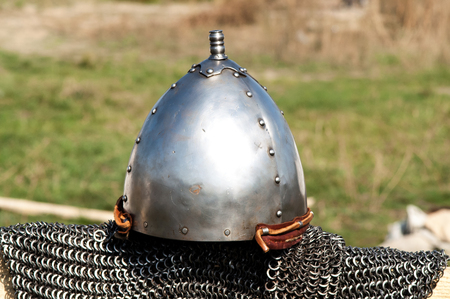 panoply: hanging single set of chain mail helmet from the Middle Ages