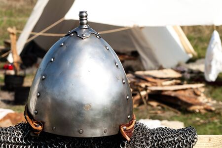 middleages: hanging single set of chain mail helmet from the Middle Ages