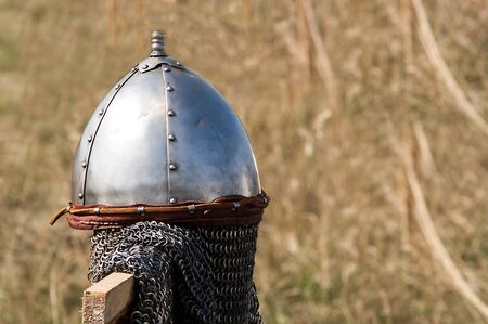 hanging single set of chain mail helmet from the Middle Ages