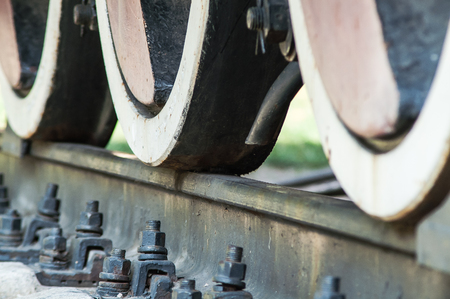 caboose: close-up train wheel brake on the railway