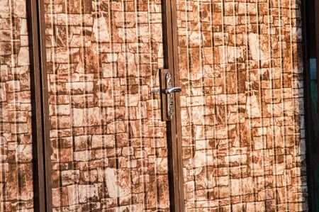 wicket door: brown camouflage wicket door in the fence Stock Photo