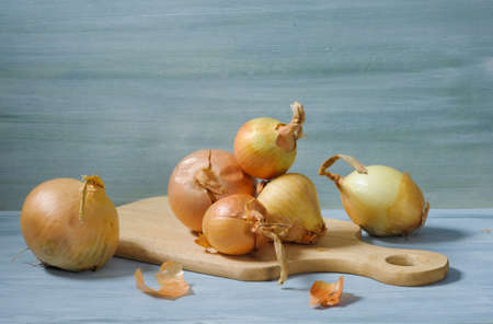 Brown onion on a wooden desk Stock Photo
