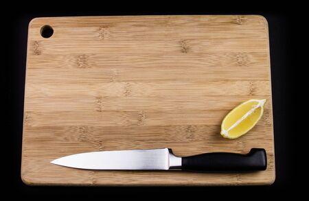 chopping board: Chopping board, knife and lemon.