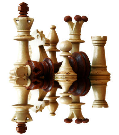 prejudice: Reflection of defeated brown chess king
